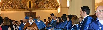 El secretario general acompaña a los profesores Martín y Prato en su acceso a la iglesia-paraninfo de San Pedro Mártir.